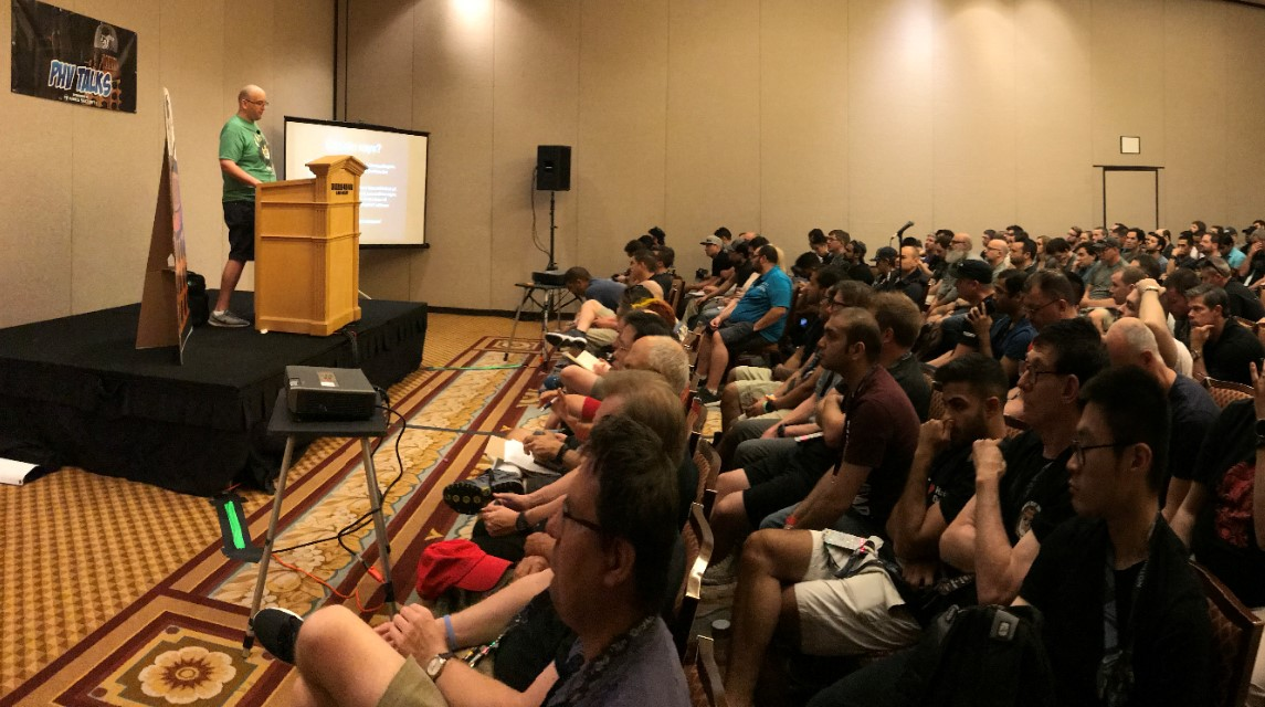 DEF CON attendees listen to a talk at the Packet Hacking Village.