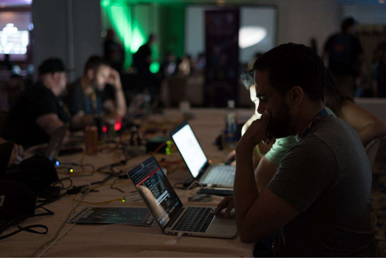 Hackers using laptops at the Packet Hacking Village at DEF CON.