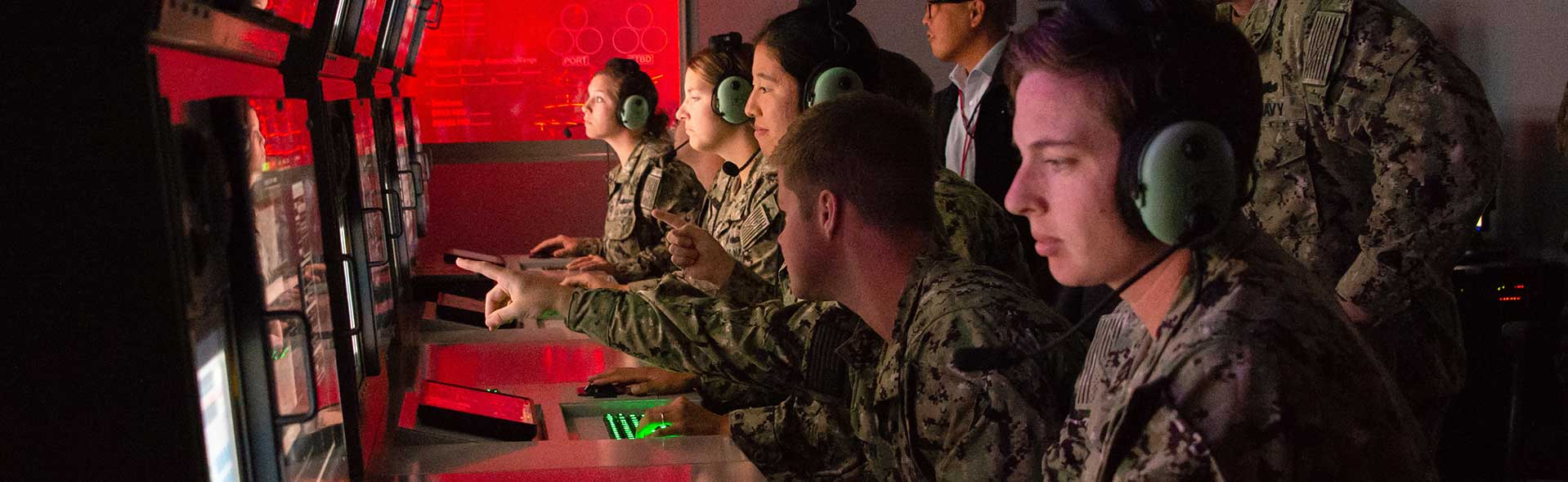 U.S. Navy technicians work on computer simulations.